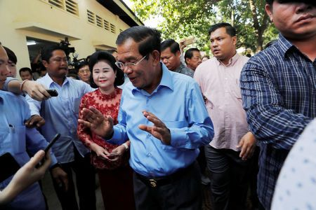 Cambodia's Prime Minister and President of the Cambodian People's Party (CPP) Hun Sen leaves after voting during a general election in Takhmao, Kandal province, Cambodia July 29, 2018. REUTERS/Darren Whiteside