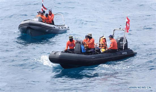 Members of Thai rescue team search for missing passengers from the capsized boat in the accident area in Phuket, Thailand, July 8, 2018. At least 42 people were confirmed dead and 14 others still missing after two boats capsized in a storm off southern Thailand's Phuket island, Thai officials said on Saturday. (Xinhua/Qin Qing)