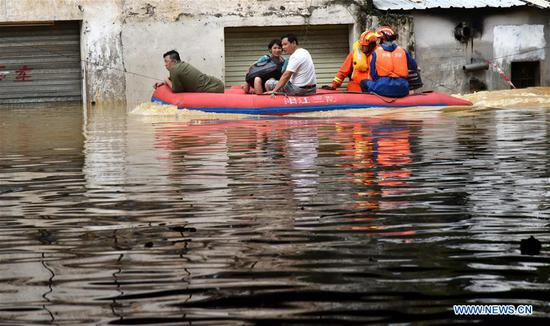 Rescuers transfer residents stranded by flood in Yangjiang, south China's Guangdong Province, Sept. 18, 2018. The city of Yangchun was hit by rainstorm after Super Typhoon Mangkhut ravaged Guangdong Province on Sunday. As of Tuesday, part of the city is still flooded, while disaster relief work is underway. (Xinhua/Zhou Ke)