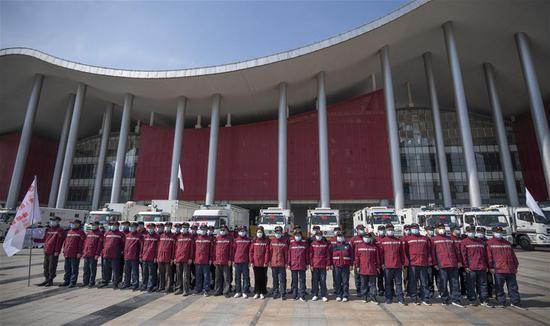 National emergency medical rescue team members gather in front of a temporary hospital in Wuhan, central China's Hubei Province, March 17, 2020. Members of 15 national emergency medical rescue teams departed Hubei Province on Tuesday as the epidemic outbreak in the hard-hit province has been subdued. (Xinhua/Cai Yang)