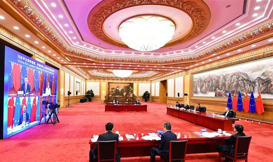 Chinese President Xi Jinping co-hosts a China-Germany-EU leaders' meeting in Beijing, capital of China, Sept. 14, 2020, via video link with German Chancellor Angela Merkel, whose country currently holds the EU's rotating presidency, European Council President Charles Michel and European Commission President Ursula von der Leyen. (Xinhua/Li Xiang)