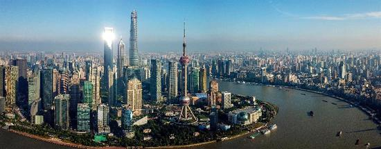 Stitched photo taken on June 21, 2018 shows scenery of the Lujiazui area in Pudong of Shanghai, east China.