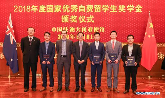Award winner representatives and guests pose for a group photo in Canberra, Australia, May 6, 2019. A total of 55 Chinese students studying in Australia received the 2018 Chinese Government Award for Outstanding Self-Financed Students Abroad, according to Chinese Ambassador to Australia Cheng Jingye on Monday. (Xinhua/Zhang Xinxin)
