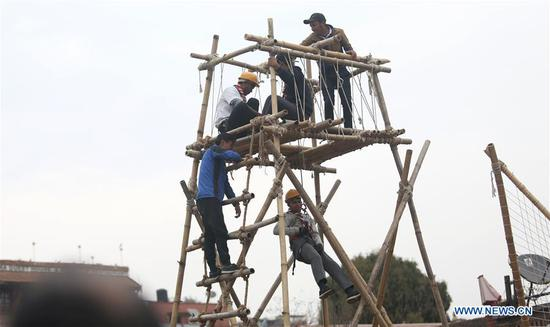People demonstrate a rescue drill during an event marking Nepal's 22nd Earthquake Safety Day at Bhaktapur Durbar Square in Bhaktapur, Nepal, Jan. 16, 2020. Nepal marked the 22nd Earthquake Safety Day on Thursday, in commemoration of the devastation caused by 1934 Nepal-Bihar earthquake. Nepal faced another earthquake on April 2015, also known as the Gorkha earthquake,which killed nearly 9,000 people and injured more than 22,000. (Photo by Sunil Sharma/Xinhua)