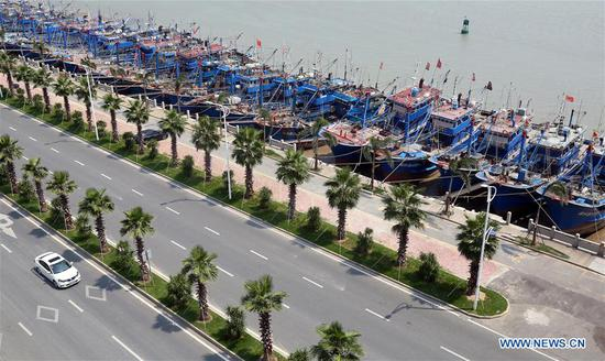 Fishing boats are seen at berth at a harbor in Quanzhou City, southeast China's Fujian Province, July 9, 2018. A yellow-level alert has been issued and third-level emergency response has been activated to cope with approaching typhoon Maria, the eighth typhoon this year, in China's coastal provinces. (Xinhua/Zhang Jiuqiang)
