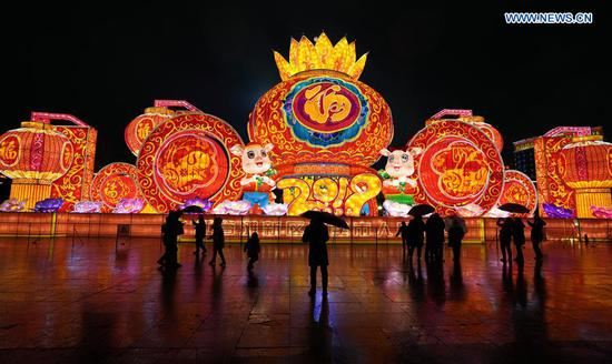 People view fancy lanterns in Nanchang City, capital of east China's Jiangxi Province, Feb. 8, 2019. Fancy lanterns in Nanchang City created a festive atmosphere during the Spring Festival holiday. (Xinhua/Song Zhenping)