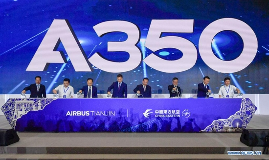 Guests attend the Airbus A350 project inauguration and first aircraft delivery ceremony at the Airbus Tianjin Widebody Completion and Delivery Center in north China's Tianjin, July 21, 2021. Airbus has inaugurated its A350 aircraft project at its widebody completion and delivery center in north China's Tianjin. It is the first time the European planemaker has launched such a project for the A350 outside Europe. (Xinhua/Sun Fanyue)
