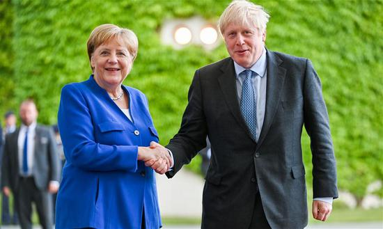 German Chancellor Angela Merkel (L) shakes hands with visiting British Prime Minister Boris Johnson in Berlin, Germany, on Aug. 21, 2019. Angela Merkel and Boris Johnson on Wednesday reiterated the Brexit with a deal, but were different in approaches. (Xinhua/Lian Zhen)