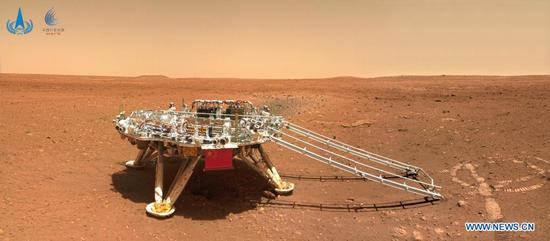 Photo released on June 11, 2021 by the China National Space Administration (CNSA) shows the landing platform of China's first Mars rover Zhurong. The China National Space Administration Friday released new images taken by the country's first Mars rover Zhurong, showing national flag on the red planet. The images were unveiled at a ceremony in Beijing, signifying a complete success of China's first mars exploration mission. The images include the landing site panorama, Martian landscape and a selfie of the rover with the landing platform. (CNSA/Handout via Xinhua)