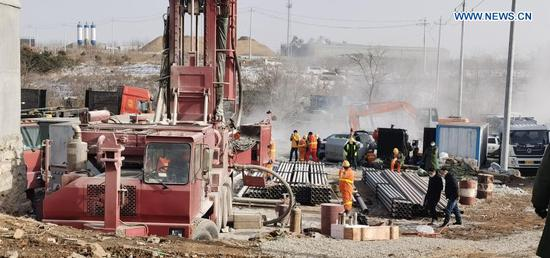Rescuers are seen at the explosion site of a gold mine in Qixia City, east China's Shandong Province, Jan. 13, 2021. More than 300 rescuers have joined the search for 22 workers who were trapped underground after an explosion ripped through a gold mine under construction in east China's Shandong Province, local authorities said Tuesday. (Xinhua)
