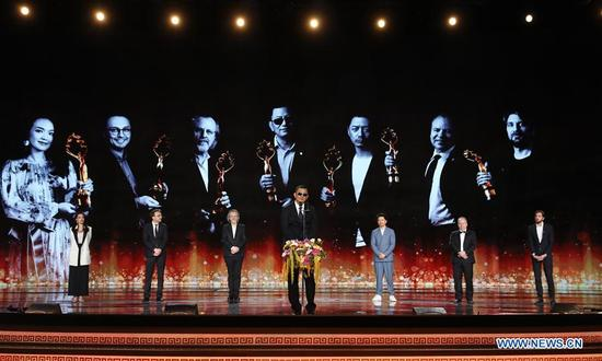 Jury members of the Tiantan Award attend the opening ceremony of the 8th Beijing International Film Festival (BJIFF) in Beijing, capital of China, April 15, 2018. (Xinhua/Yin Gang)