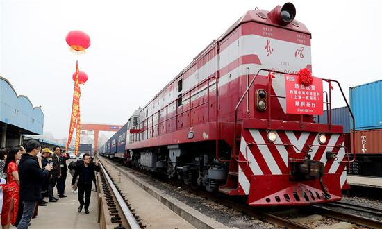 A departure ceremony of China-Europe freight train service for cross-border e-commerce is held at Yangpu Station in Shanghai, east China, March 30, 2018. (Xinhua/Fang Zhe)