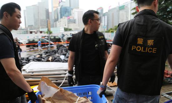 Hong Kong police are collecting evidence from the LegCo Complex of Hong Kong which was stormed and ransacked by violent protestors on July 1.Photo: Chen Qingqing and Yang Sheng/GT