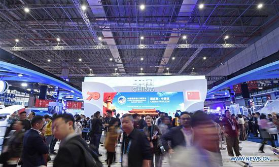 People visit the China pavilion during the second China International Import Expo (CIIE) in Shanghai, east China, Nov. 6, 2019. The China pavilion showcases achievements China has made over the past 70 years, as well as its culture and landscape. (Xinhua/Wang Peng)