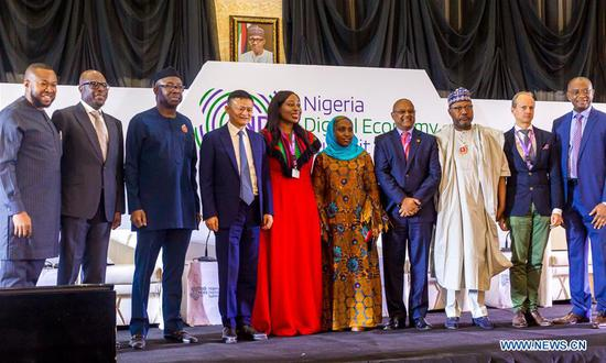 Jack Ma (4th L), the founder of China's e-commerce giant Alibaba, attends the Nigeria Digital Economy Summit in Abuja, Nigeria, on Nov. 14, 2019. Jack Ma pledged on Thursday to promote an inclusive digital economy in Africa. (Photo by Japhet Adenuga/Xinhua)