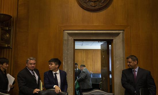 Hong Kong secessionist Joshua Wong (3rd L) leaves after a hearing at the Congressional-Executive Commission on China in Washington, DC, on September 17, 2019. Photo: AFP