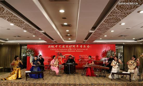Chinese artists perform during a concert to celebrate the 67th anniversary of the establishment of China-Pakistan Diplomatic Relations in northwest Pakistan's Peshawar, on May 13, 2018. A Chinese concert was held in Peshawar on Sunday to celebrate the 67th anniversary of the establishment of China-Pakistan Diplomatic Relations. (Xinhua/Ahmad Kamal)