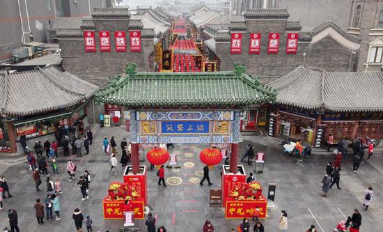 Aerial photo shows people visiting an ancient cultural street in Tianjin, north China, Feb. 13, 2021. Many people visited the street on the second day of the Chinese Lunar New Year. (Xinhua/Zhao Zishuo)