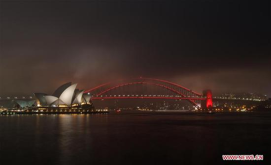 Photo taken on Feb. 1, 2019 shows the Sydney Harbour Bridge, which is lit up in red to celebrate the Chinese Lunar New Year, in Sydney, Australia. (Xinhua/Bai Xuefei)