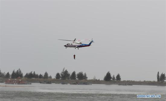 A helicopter participates in a drill in Haikou, south China's Hainan Province, April 30, 2019. A comprehensive drill on typhoon was held in Haikou to test the response ability to the emergency. (Xinhua/Yang Guanyu)