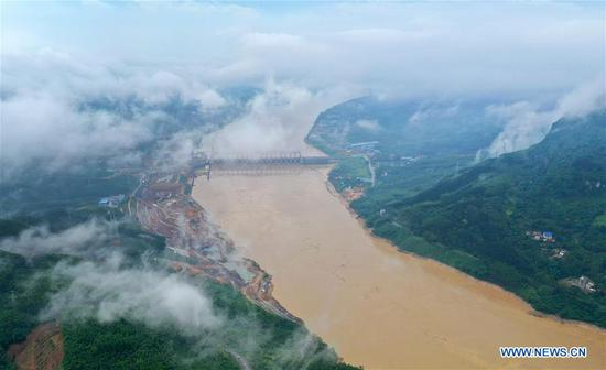 Aerial photo taken on June 10, 2019 shows Honghua Hydropower Station in Yufeng District of Liuzhou City, south China's Guangxi Zhuang Autonomous Region. Due to downpours in the upper reach of the Liujiang River, the first flood peak of the river arrived in Liuzhou on Monday. (Xinhua/Li Hanchi)