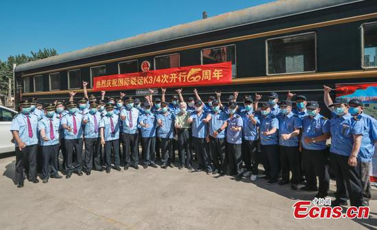 Conductors from the China Railway Beijing Group Co pose in front of the K3/4 train, which runs from Beijing to Moscow via Ulan Bator, after an overhaul in Beijing on May 19, 2020. The route began on May 24, 1960. (Photo: China News Service/Jia Tianyong)