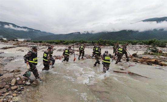 Rescuers work in Yihai Town of Mianning County, southwest China's Sichuan Province, June 28, 2020. Twelve people died and 10 others were missing as of 4 p.m. Sunday after a heavy rainstorm hit Mianning County in southwest China's Sichuan Province, local authorities said late Sunday. (Photo by Wang Yun/Xinhua)