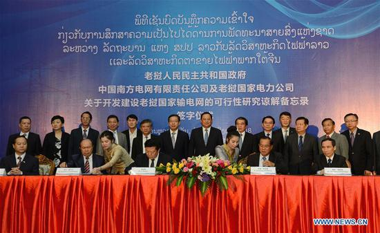 Delegates sign a Memorandum of Understanding (MOU) in the Lao capital Vientiane on Aug. 8, 2018. China Southern Power Grid (CSG) has signed a MOU over feasibility study on cooperatively developing and building Laos' national power grid in Vientiane. (Xinhua/Liu Ailun)