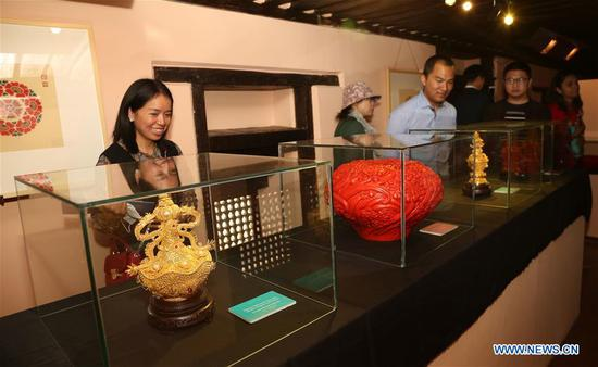 People visit an exhibition of China's Intangible Cultural Heritage in Lalitpur, Nepal, Nov. 6, 2019. The exhibition of