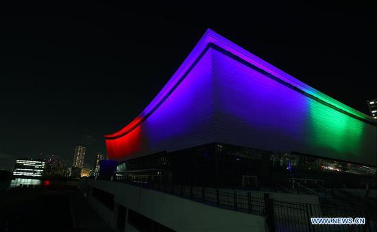 The Tokyo 2020 Paralympic Venue Ariake Arena is illuminated with the Paralympic symbol colours to mark one-year-to-go until the start of the postponed Tokyo 2020 Paralympic Games in Tokyo, Japan, Aug. 24, 2020. (Xinhua/Du Xiaoyi)