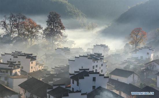 Photo taken on Nov. 24, 2018 shows morning scenery of Chengcun Village in Wuyuan County, east China's Jiangxi Province. (Xinhua/Hu Dunhuang)