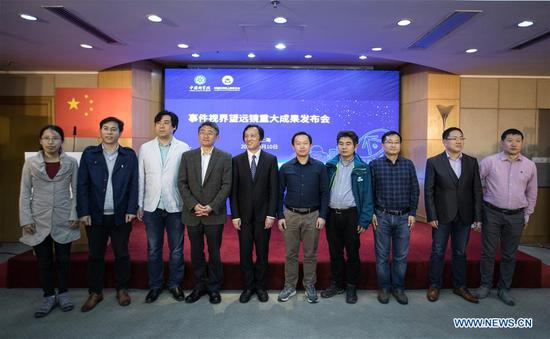 Some Chinese astronomers who have made contributions to a global effort to capture the first-ever image of a supermassive black hole at the heart of the distant galaxy M87, pose for a group photo during a press conference held in Shanghai Astronomical Observatory (SAO), in east China's Shanghai, April 10, 2019. The image of the black hole, based on observations through the Event Horizon Telescope (EHT), a planet-scale array of eight ground-based radio telescopes forged through international collaboration, was unveiled in coordinated press conferences across the globe at around 9:00 p.m. (Beijing time) on Wednesday. The landmark result offers scientists a new way to study the most extreme objects in the universe predicted by Albert Einstein's general relativity. (Xinhua/Jin Liwang)