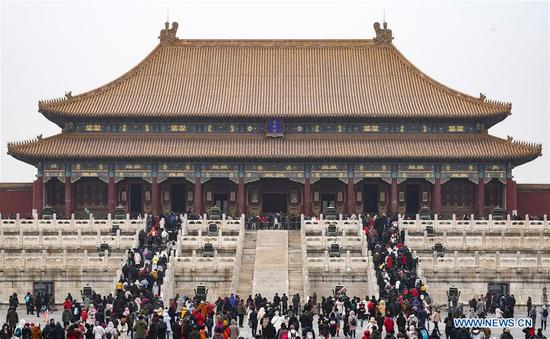 Tourists visit the Palace Museum in Beijing, capital of China, Feb. 5, 2019, the first day of Chinese Lunar New Year. (Xinhua/Shen Bohan)
