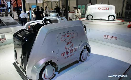 Photo taken on Aug. 20, 2019 shows 5G unmanned delivery vehicles of JD Logistics during the 2019 World Robot Conference in Daxing District of Beijing, capital of China. The 2019 World Robot Conference, themed