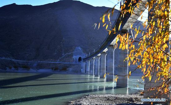 Photo taken on Dec. 1, 2019 shows a bridge above the Yarlung Zangbo River of Lhasa-Nyingchi railway in Sangri County of Shannan, southwest China's Tibet Autonomous Region. The rail-laying work of a 4,615-meter-long bridge crossing the Yarlung Zangbo River of Lhasa-Nyingchi railway was completed on Sunday. The Lhasa-Nyingchi railway features complex geological conditions, with a total length of 435 km, 75 percent of which are bridges and tunnels. The construction work began in 2015 and is expected to be completed in 2021. (Xinhua/Chogo)
