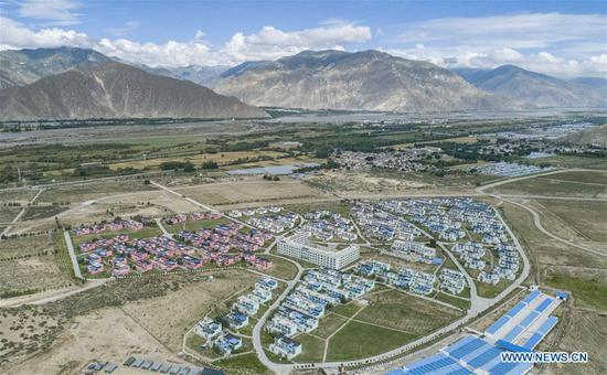 Aerial photo taken on Aug. 24, 2020 shows a relocation site in Quxu County of Lhasa, southwest China's Tibet Autonomous Region. Southwest China's Tibet Autonomous Region has accomplished the historical feat of eradicating absolute poverty, according to a press briefing held in the regional capital of Lhasa on Thursday. (Xinhua/Sun Fei)