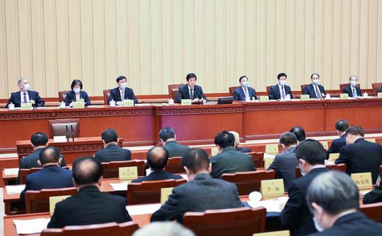 Li Zhanshu, chairman of the National People's Congress (NPC) Standing Committee, presides over the closing meeting of the 26th session of the 13th NPC Standing Committee at the Great Hall of the People in Beijing, capital of China, Feb. 28, 2021. (Xinhua/Li Tao)