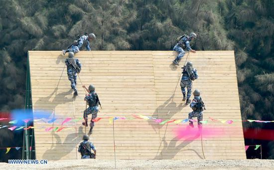 Chinese team members participate in the survival trail event of the International Army Games 2018