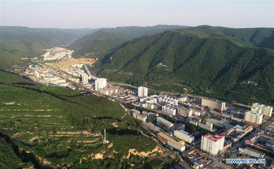 Aerial photo shows a view of Huanglong County in Yan'an, northwest China's Shaanxi Province on May 31, 2018. Yan'an, a former revolutionary base of the Communist Party of China (CPC), is no longer labeled