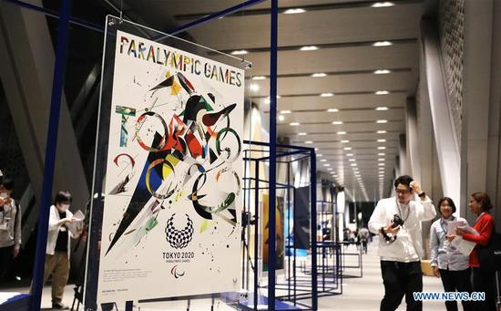Reporters visit the preview of Tokyo 2020 Olympics Official Art Poster Exhibition in Tokyo, Japan, Jan. 6, 2020. (Xinhua/Du Xiaoyi)