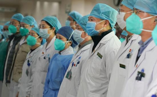 "Medical staff of Union Hospital affiliated to Tongji Medical College of Huazhong University of Science and Technology attend a ceremony to form a ""assault team"" in the fight against the pneumonia caused by the novel coronavirus in Wuhan, Jan. 22, 2019. (Xinhua/Cheng Min)"