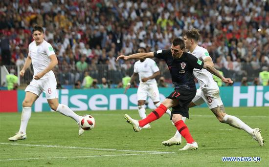 Dejan Lovren (top) of Croatia competes for a header during the 2018 FIFA World Cup semi-final match between England and Croatia in Moscow, Russia, July 11, 2018. (Xinhua/Yang Lei)