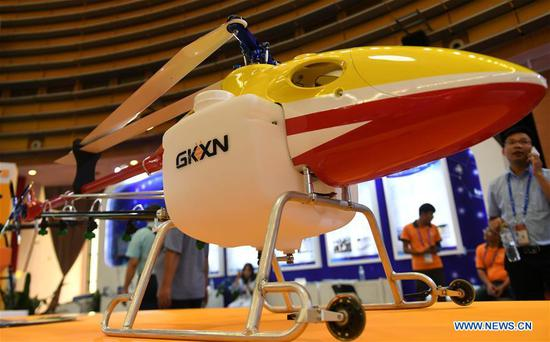 Photo taken on Sept. 13, 2018 shows a civilian drone at the 15th China-ASEAN Expo in Nanning City, south China's Guangxi Zhuang Autonomous Region. High-tech exhibits attracted many visitors at the expo. (Xinhua/Zhang Ailin)