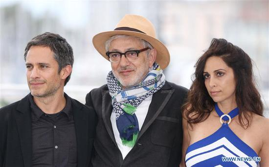 Director Elia Suleiman (C), actor Gael Garcia Bernal and actress Yasmine Hamdan pose during a photocall for