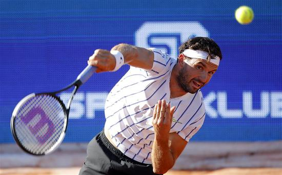 Grigor Dimitrov of Bulgaria serves to Dominic Thiem of Austria during their match at the tennis tournament Adria Tour in Belgrade, Serbia on June 14, 2020. (Xinhua/Predrag Milosavljevic)