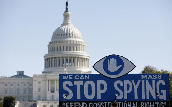 File photo taken on Oct. 26, 2013 shows a huge slogan board stands in front of the U.S. Capitol building during a protest against government surveillance in Washington D.C., the United Sates. (Xinhua/Fang Zhe)