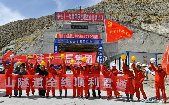 Workers celebrate the holing-through at the construction site of the Galashan Tunnel in Lhasa, southwest China's Tibet Autonomous Region, April 7, 2018. The 4,373-km-long tunnel, about 3,600 meters of altitude, is part of the Lhasa to Nyingchi railway. (Xinhua/Zhang Rufeng)