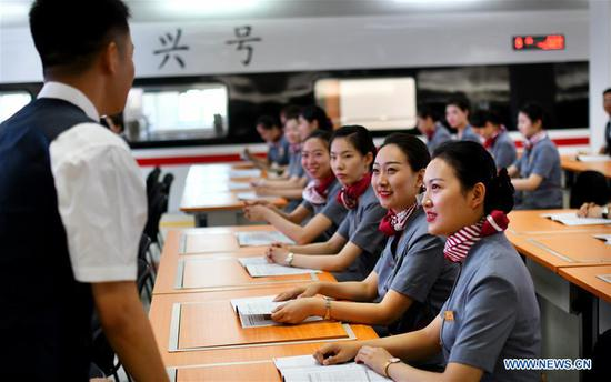 Stewardesses of the high-speed railway linking Tianjin and Hong Kong receive training in north China's Tianjin, June 30, 2019. The first high-speed railway linking Tianjin and Hong Kong will be put into use on July 10, according to Tianjin's railway authorities. The bullet train, G305, will depart Tianjin West Railway Station at 10:58 a.m. and arrive at Hong Kong West Kowloon Station at 9:02 p.m. The second-class seat for the 10-hour ride will cost 1,092.5 yuan (about 158 U.S. dollars). After the launch of the new route, the number of high-speed railway stations on the Chinese mainland that link Hong Kong will increase to 58. (Xinhua/Yang Baosen)