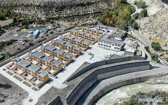Aerial photo taken on Sept. 21, 2019 shows the government-funded dwellings in Lhozhag Town of Lhozhag County, Shannan City, southwest China's Tibet Autonomous Region. A total of 88 villagers from 28 households moved to their new two-story dwellings to improve housing conditions. (Xinhua/Jigme Dorje)