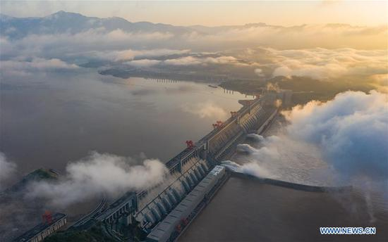 Aerial photo taken on July 27, 2020 shows floodwater being discharged from the Three Gorges Dam in central China's Hubei Province. The third flood of the year in the Yangtze River occurred in its upper reaches as the Three Gorges reservoir saw an inflow of 50,000 cubic meters per second at 2 p.m. Sunday. (Photo by Zheng Jiayu/Xinhua)